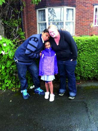 Kyle, left, with mum Carol McInerney and sister Angel, 10.