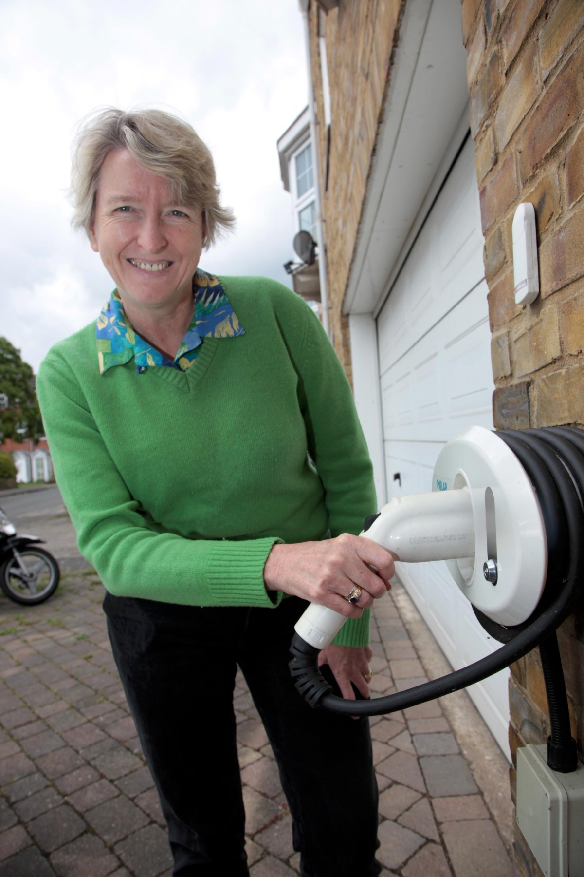 Liz Collins with her driveway electric charge point