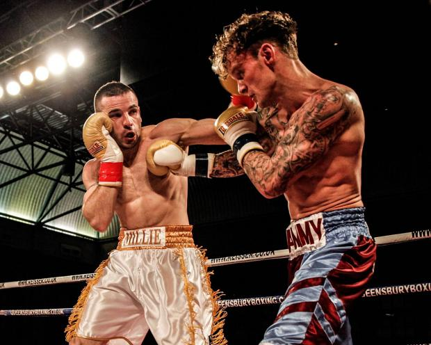 All out action: New Addington's Gareth Gardner, left, in the Queensbury Boxing League