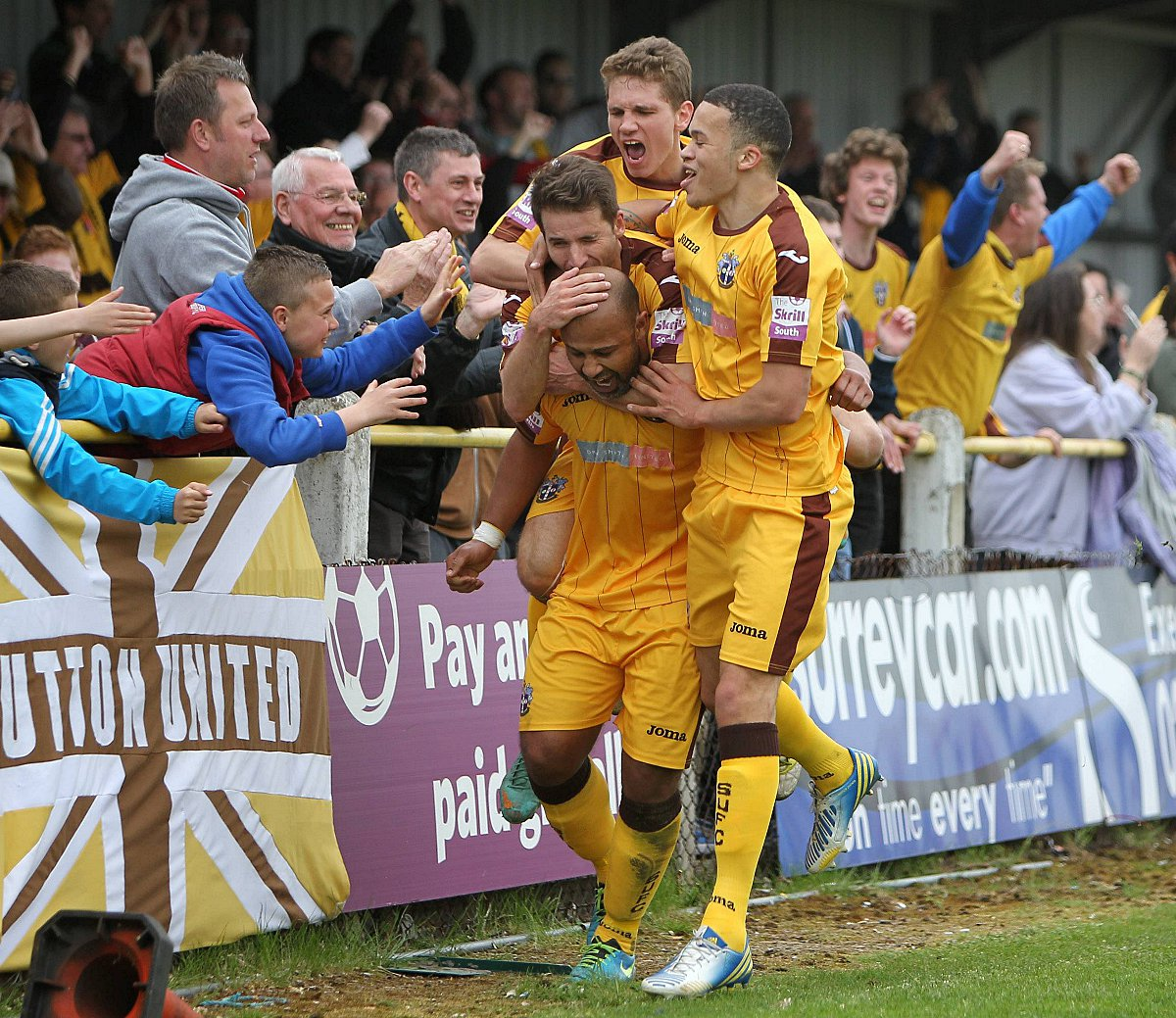 Happy memories: Simon Downer is mobbed after scoring the 3-1 win over Ebbsfleet at the back end of last season               All pictu