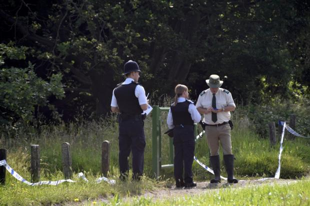 Police investigating at the scene on Wimbledon Common yesterday