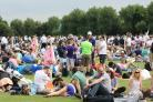 Crowds gather in Wimbledon Park hoping to get their hands on tickets.