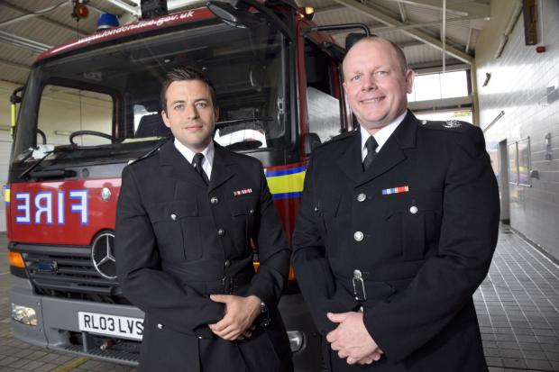 Old and new: Rick Ogden, left, hands over control to new borough commander Neil Withers in July