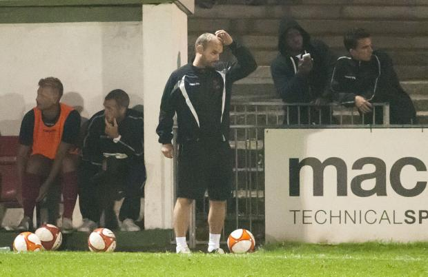 Wimbledon Guardian: In need of support: New Ks boss Tommy Williams during a tricky spell at Carshalton Athletic