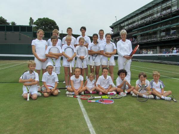 Judy Murray, back right, helps out with the Wimbledon Junior Tennis Initiative.