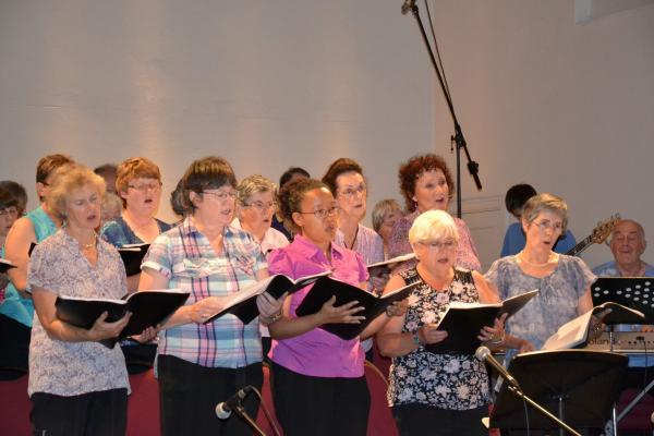The Inspire Community Choir performs at the Summer Concert event