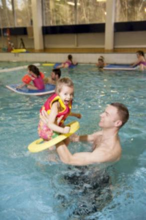 Splashing about: A family enjoys the facilities in Morden.