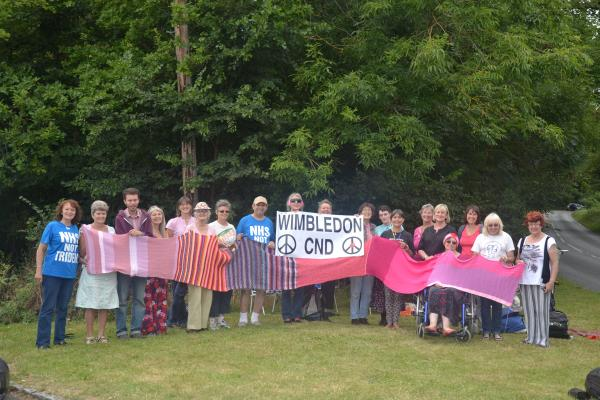 Campaigners at the site in Berkshire with some of the scarf. Photo: Auriel Glanville.