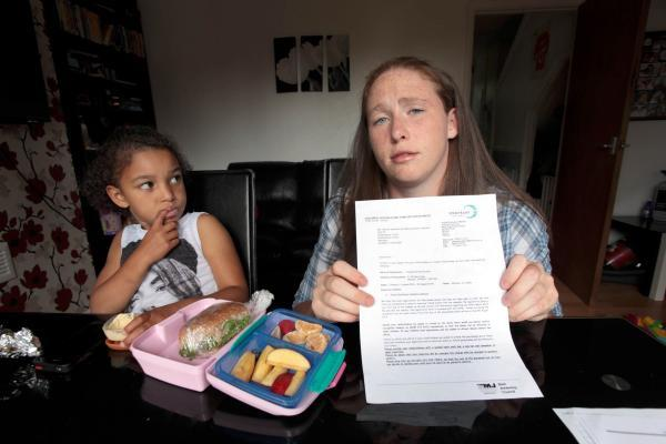 Amari, 5, with mum Yasmin Jackson and a letter from Merton Council asking her to bring a packed lunch.