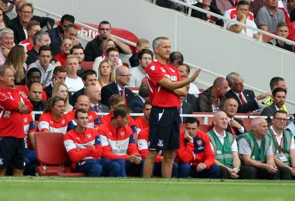 Staying level-headed: Keith Millen in the dug-out at Arsenal on Saturday