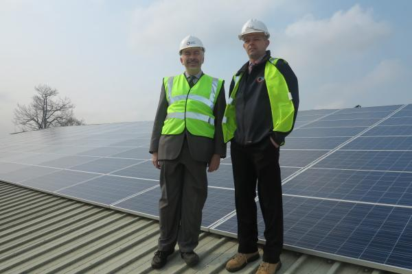 Councillor Andrew Judge inspecting solar panels at the Canons Leisure Centre in Mitcham.