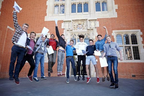 High-flyers: Boys at King's College celebrate their GCSE results today.