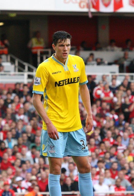 Martin Kelly makes his debut in the opening day 2-1 defeat at Arsenal