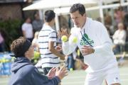 Tennis clinic: Former British number one Tim Henman takes time out to put youngsters through their paces at Sutton Tennis & Squash Club