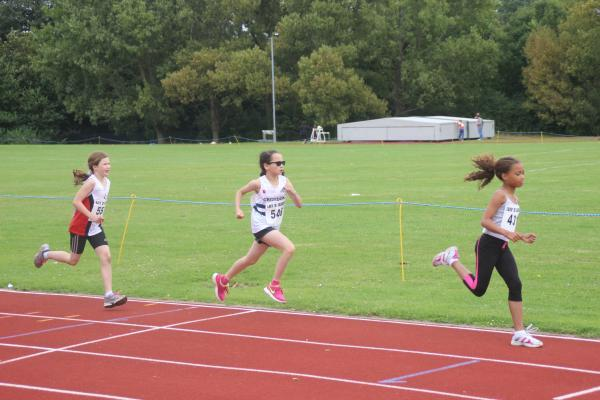 Eye-catching: Jessica Moore, middle, ran well for Croydon Harriers in the Lily B League
