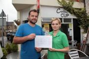 Stephen and Adele Theron with the petition to stop shop's closure