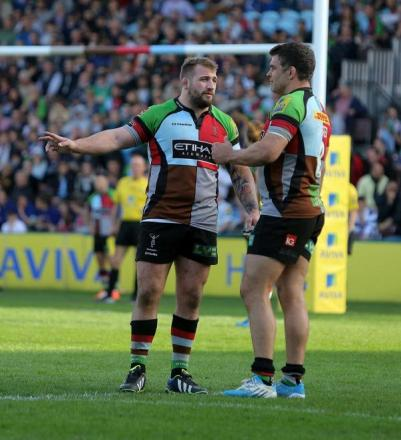 Taking advise: Joe Marler and Nick Easter chew the fat during a match last season