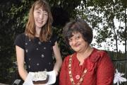 Deputy mayor of Merton, Councillor Laxmi Attawar with Cressida Knapp judging the cake competition