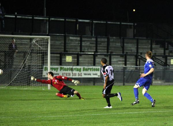 Up and running: Howard Newton equalises for Tooting & Mitcham United in Tuesday night's 3-1 FA Cup win over Bishop's Stortford                SP87826