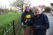 Tom Walsh from Sustainable Merton and Councillor Geraldine Stanford painting a fence
