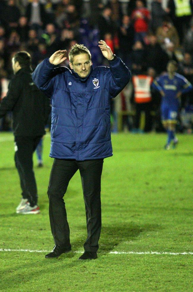 Close: Neal Ardley salutes the Dons support after last night's defeat to Liverpool      SP89202