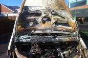 A burnt out shell: One of the destroyed minibuses