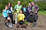 Keith Spears, centre, with planting volunteers including Auriel Glanville and Merton's mayor. Picture: Auriel Glanville