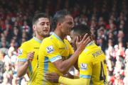 Happy days: Joel Ward and Marouane Chamakh give goal-scorer Jason Puncheon their blessing