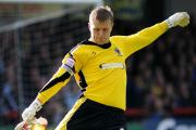 Committed: Former AFC Wimbledon keeper Seb Brown has agreed terms to play for Hampton & Richmond Borough next season