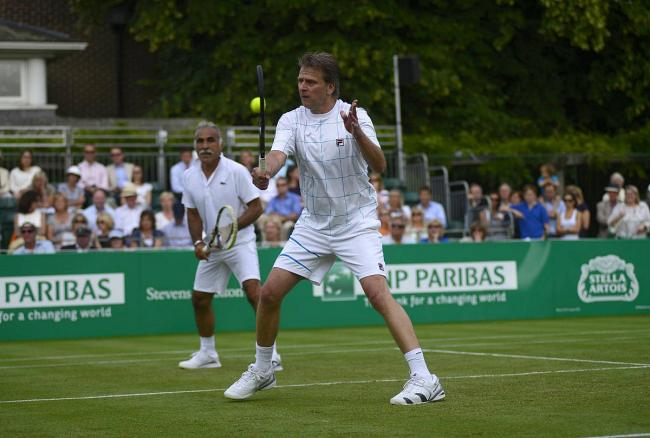 Legends: Former British number one Andrew Castle and Mansour Bahrami in action at Hurlingham last year