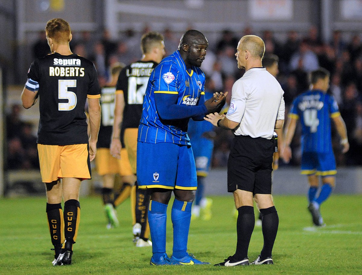 Making a point: Adebayo Akinfenwa reckons AFC Wimbledon's strength in depth is key to their League Two successes