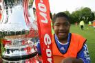 Cup pedigree: Met Police striker Tane Caubo pictured as a nine-year-old next to the FA Cup on Wandsworth Common. The teenager is now eyeing FA Trophy success 	WA13199