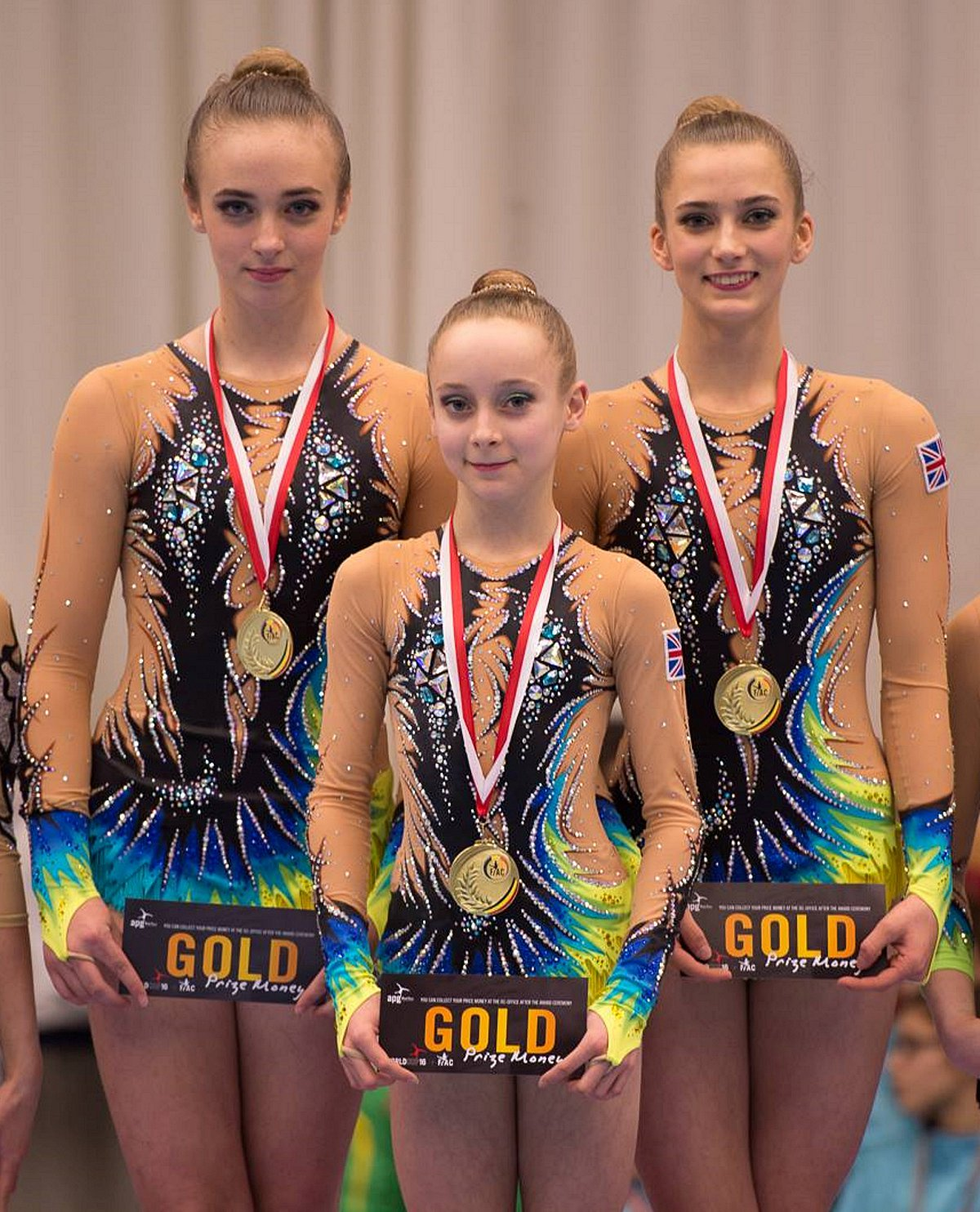 Golden girls: RGA's Tabbie Dawson, Kitty Williams and Scarlett Wright with their Flanders International Acro Cup gold medals