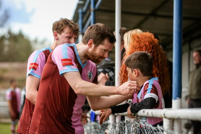 Hard to take: Dave Hodges consoles an unhappy Corinthian Casuals fan        Picture: Stuart Tree