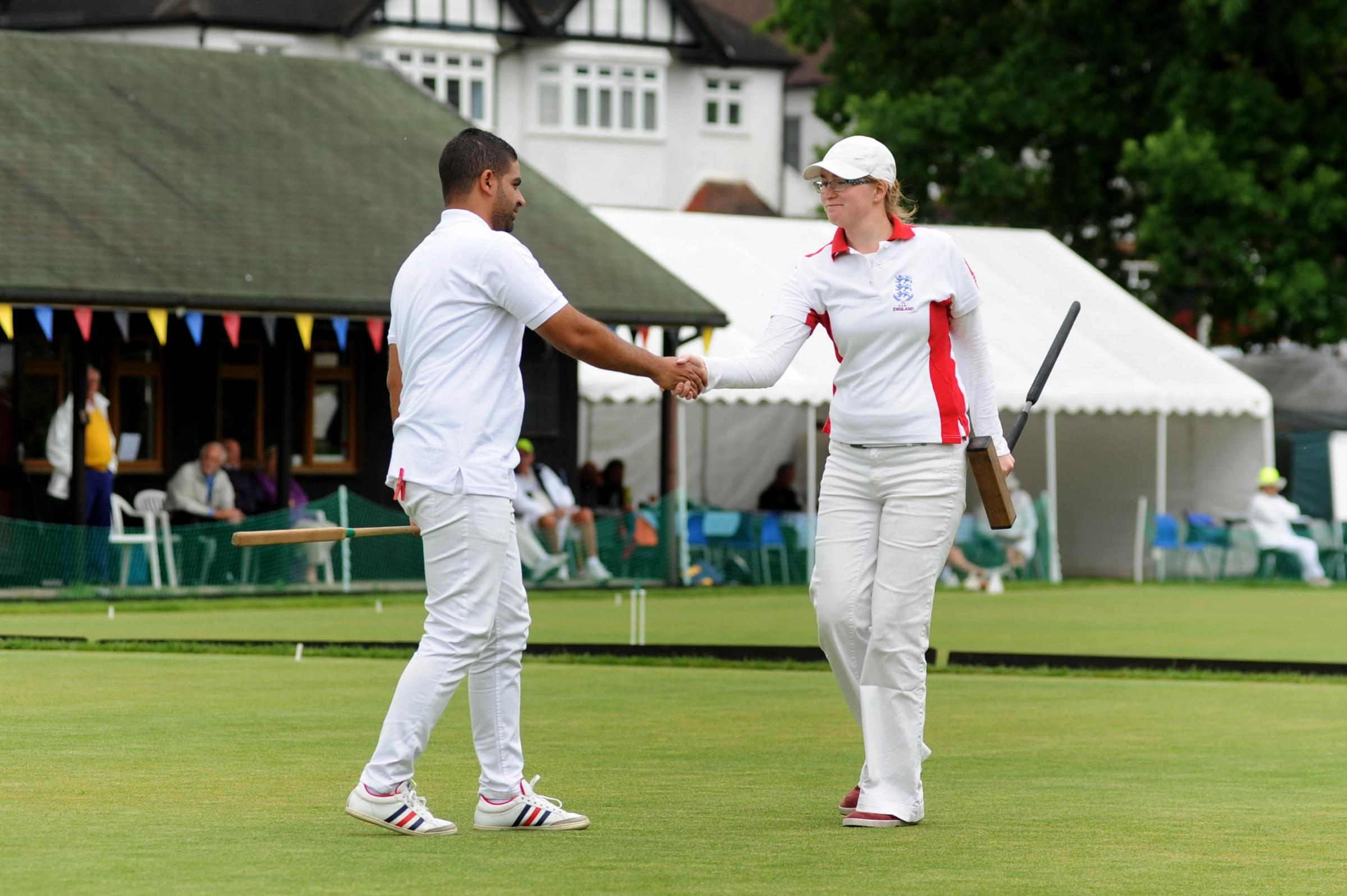 Disappointed: England's Rachel Lowe shakes hands with Egypt's Mohamed Kerem after defeat this week