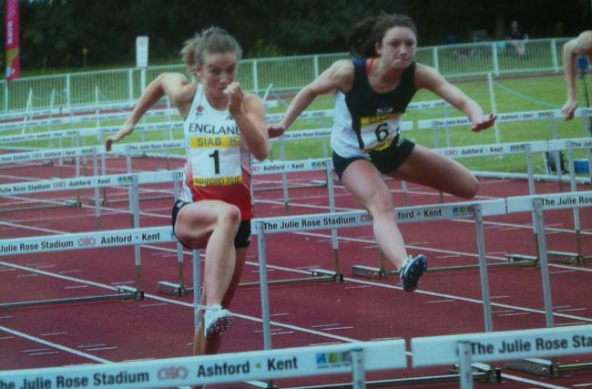Leading the Earley charge: Kingston's Pippa Earley, left, leads the way in the U17 women's 80m hurdles at the SIAB Schools' International championship in Ashford at the weekend