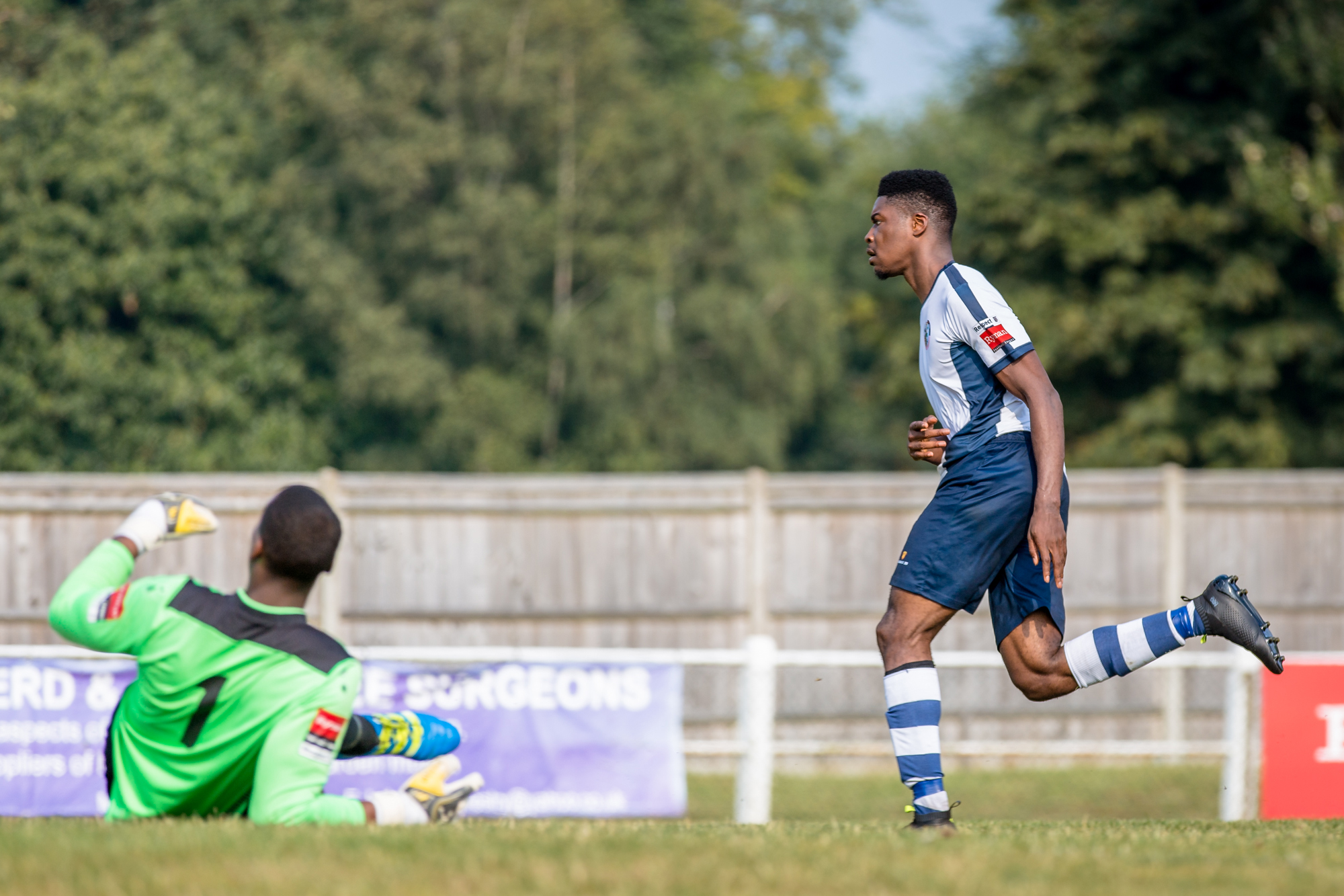 Boom: Corinthian Casuals striker Shaun Okojie scores the winner against Godalming Town in August