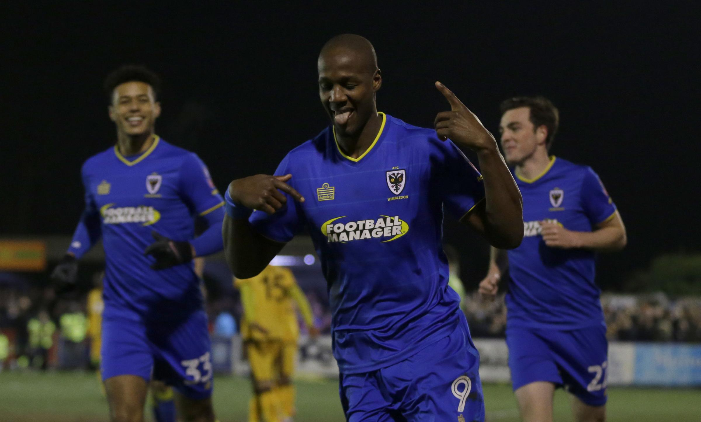 AFC Wimbledon's Tom Elliott celebrates after scoring against Sutton United - but the night was to end is disappointment for the Dons