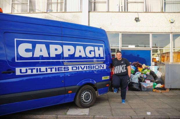 Wimbledon Guardian: Van driver Dean Yates with donations in Staines, north Surrey