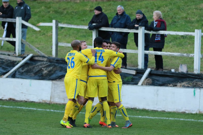 Sutton Common Rovers surround Matt Farrell after his match winning goal at Farnham Town on Saturday