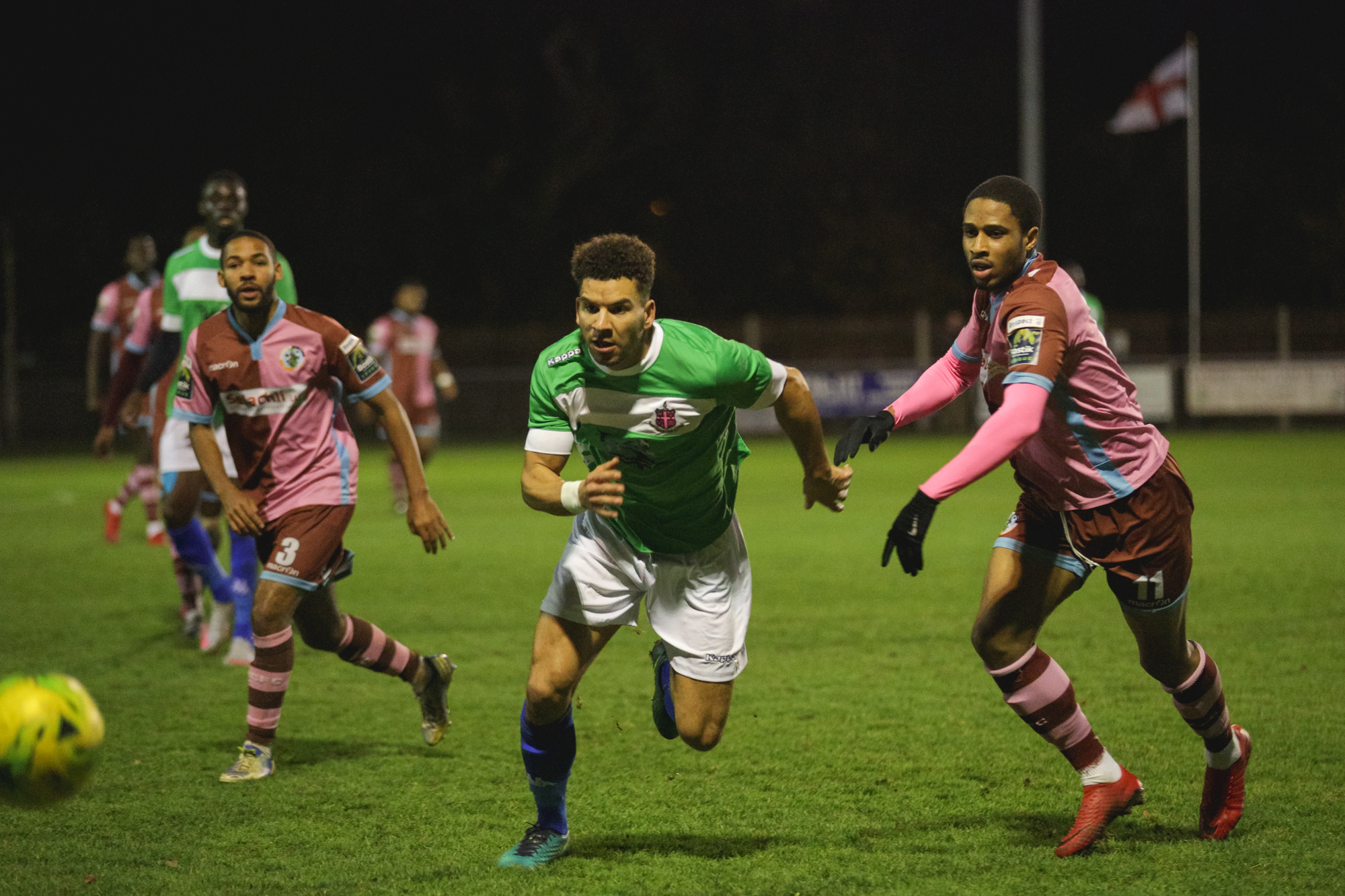 Corinthian-Casuals (pink shirts) gave a spirited performance against Dulwich Hamlet on Tuesday night. Picture: Stuart Tree