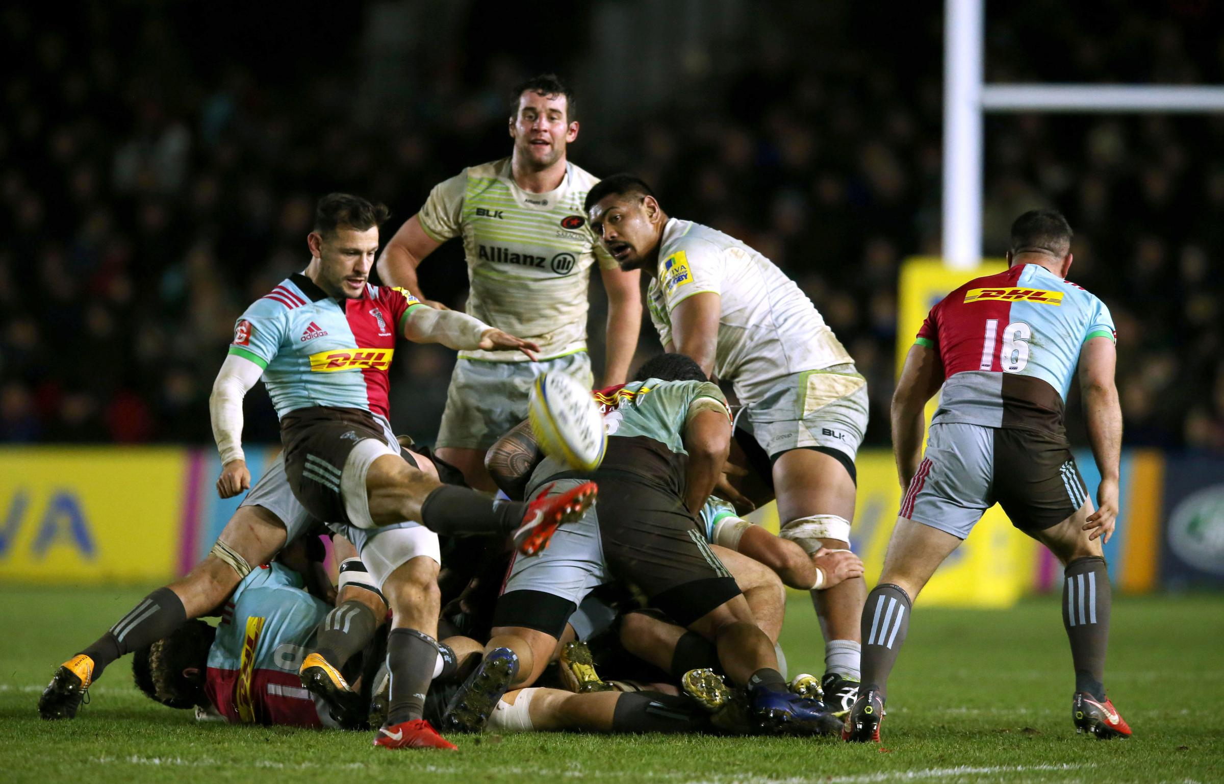 Harlequins' Danny  Care kicks the  ball away against  Saracens. Photo: Paul Harding/PA Wire.