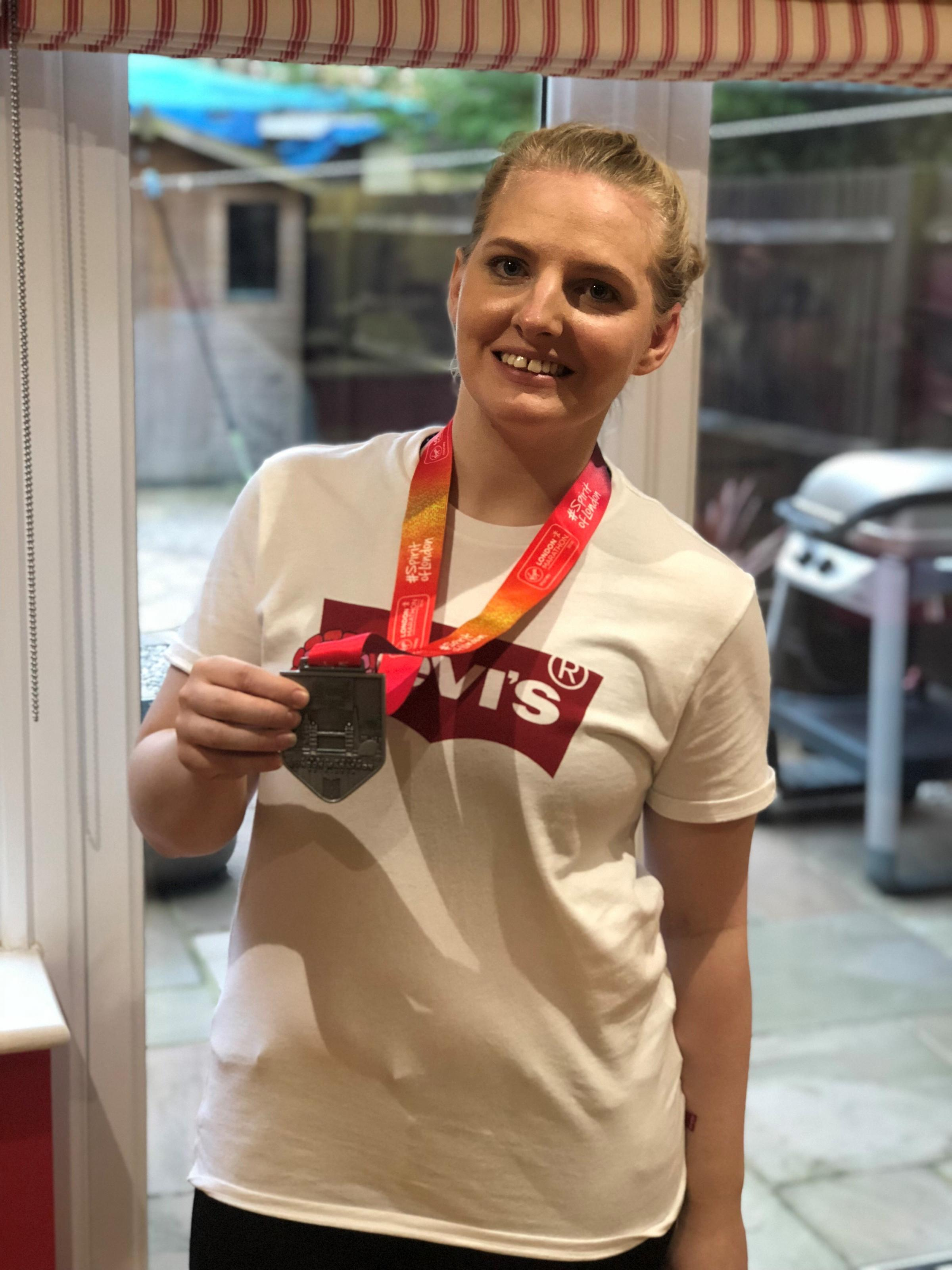 Abbey Bryan with medal after completing London Marathon
