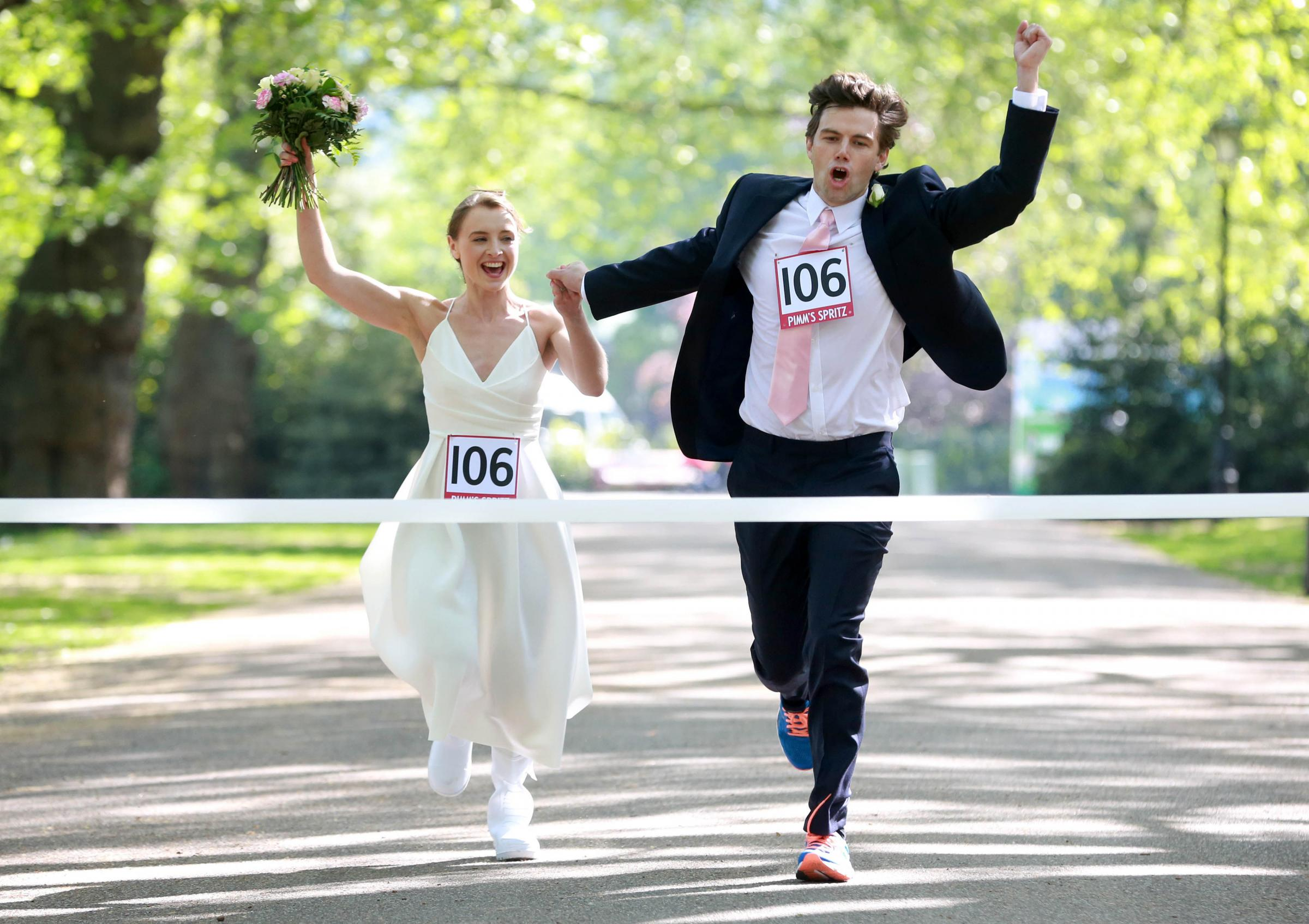 Bride-to-be Jade Woolett and her groom Daniel Carey from Wimbledon celebrate as they win the Pimm's Spritz Wedding Dash. Photo. Picture date: Tuesday May 8, 2018. The drinks brand is hosting the competition to launch their new Spritz cocktail, just in