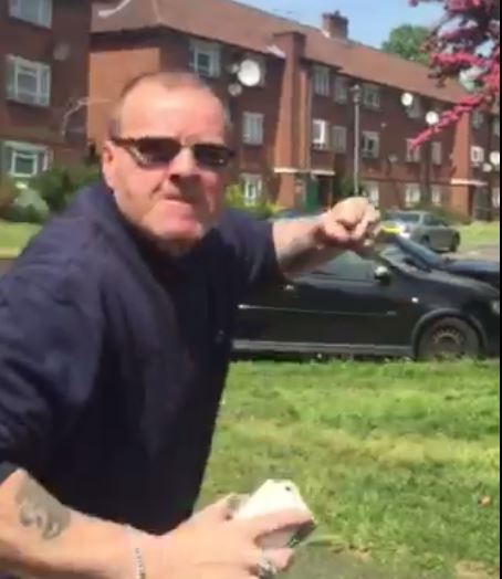A still shows a man believed to be a Clarion Housing employee threatening a a resident in Wimbledon