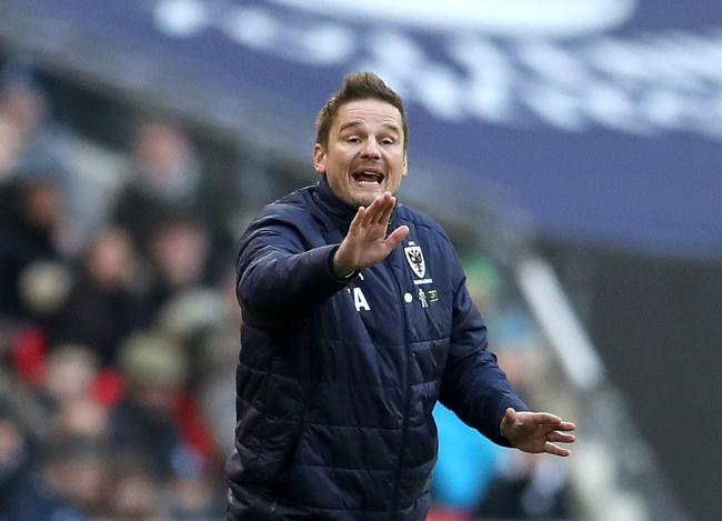 Neal Ardley guided AFC Wimbledon to their first ever victory in the EFL Cup at Portsmouth on Tuesday. Picture: PA