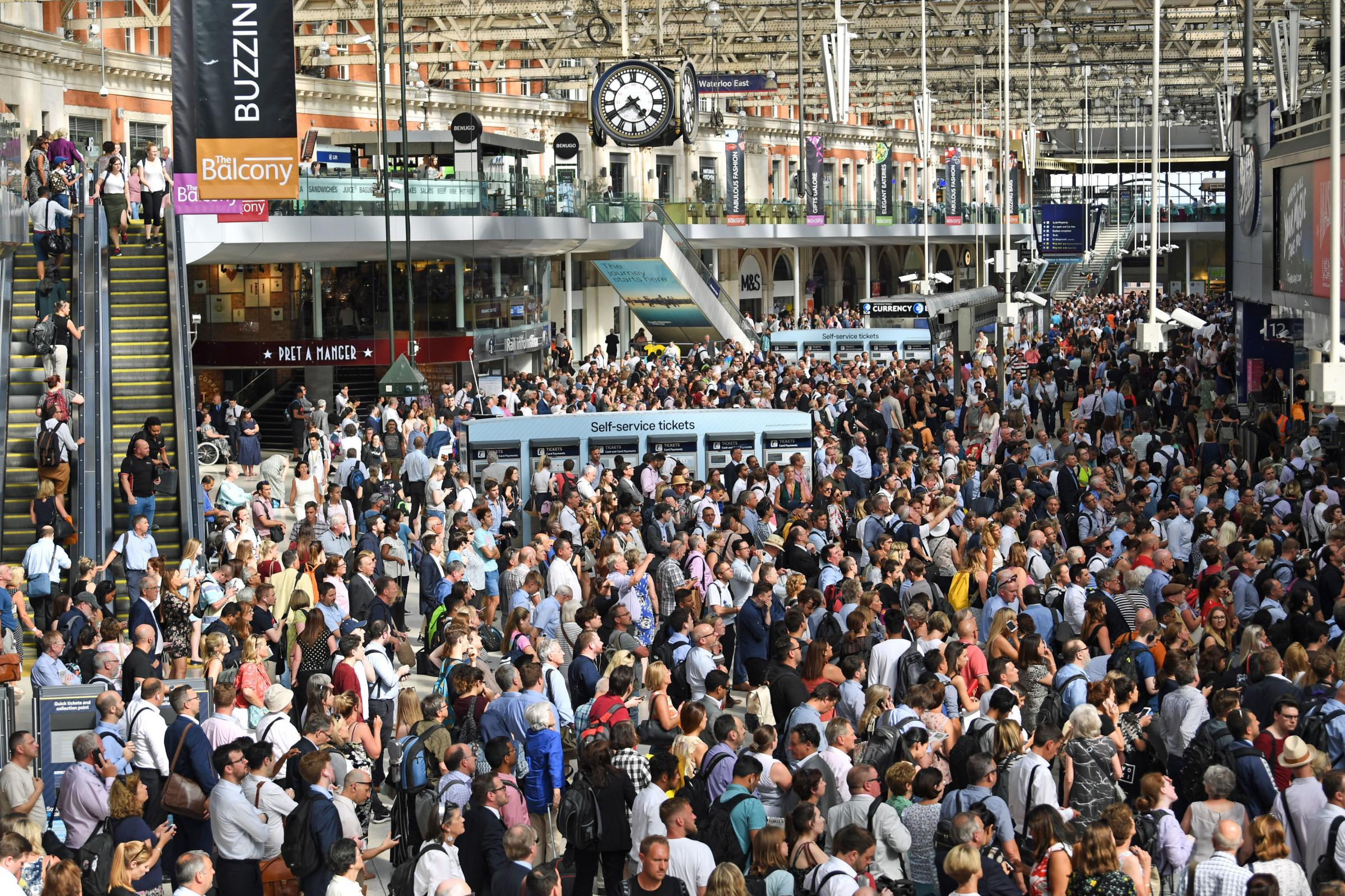 Commuters waiting for trains at Waterloo Station. Picture: Victoria Jones/PA Wire